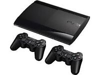 Sony PlayStation 3 with 2 remotes and 5 games