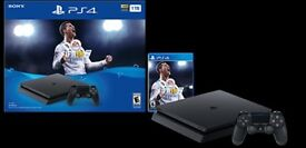 Playstation 4 boxed with 4 of tge latest games