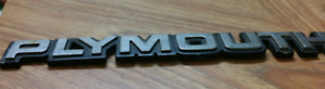T-bird keychain and plymouth and Skyhawks emblems