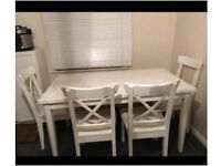 White shabby chic table with 4 white wooden chairs