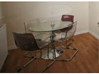 round glass dining table with 4 chairs