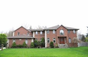 WELL MAINTAINED 4,200 SQ FT BRICK TO ROOF 2 STY W3.5 CAR GARAGE