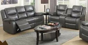 NEW 2 Piece Reclining Sofa Set in a Grey Gel Leather Regular Retail $2599. ETA December 15, 2017. Set includes Sofa and