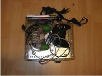 Original clear Xbox + 4 games. Good condition!
