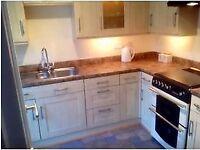 Kitchen units cupboards cabinets worktop sink mixer taps splashback