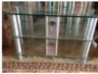 Clear glass TV corner table stand - takes big TV and has shelf