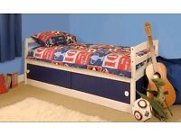 White wooden single cabin bed with blue sliding storage