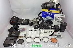 Camera lot with lenses and a large lot of filters. A