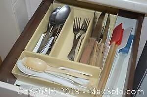 Three Drawers Of Utensils A