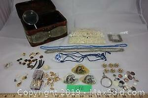 Jewelry making supplies with semi-precious stones, abalone, porcelain and a vintage magnifying glass A