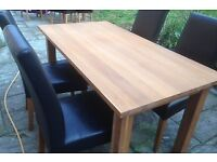 solid oak table and four leather chairs