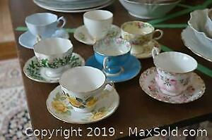 7 Tea Cups and Saucers A