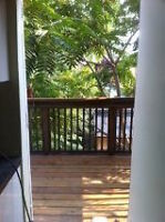 A bright and spacious two story, two bedroom apartment in the he