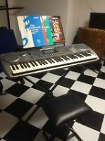 Keyboard, stand, stool and various instruction books