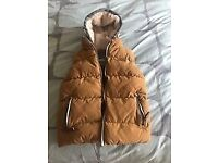Boys 8 year Next Gilet/Bodywarmer. Mustard colour, fleecy hood, 2 pockets, zip up. Great condition