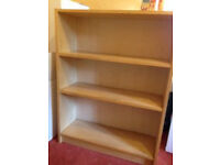 3 shelves bookcase in beech wood. 106cm H 80cm W 28cm D. Collect from B15. £15