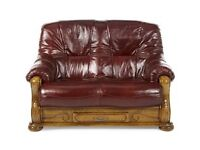 2 Two seater leather sofas plus footstool