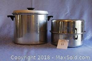 Large pot and stainless steel roasting pan with lid
