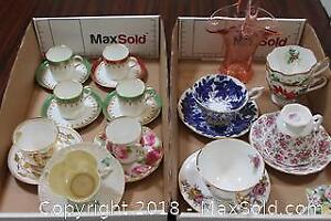 Tea Cups and Saucers. A