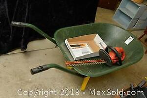 Wheel Barrow and Hedge Trimmer. A