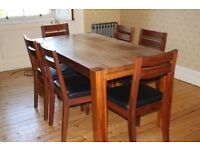 Beautiful solid wood dining table and six chairs with black leather seats. Excellent condition.