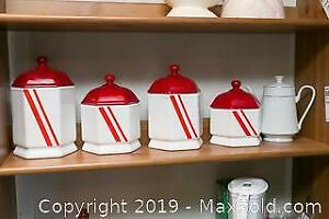 Four China Canisters A