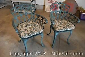 Pair Of Patio Chairs. A