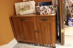 Sewing Machine, Table And Accessories. B