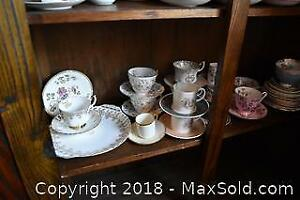 Plates Cups And Saucers. B