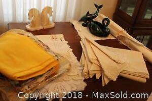 Linens And Marble Figures. A