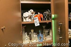 Perfume Bottles and Elephant Figurines A