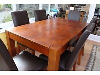 Dark solid oak 'Newport' dining table and 6 dark oak and leather chairs