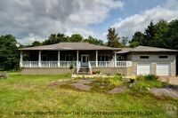 CUSTOM BUILT BUNGALOW 70 ACRES