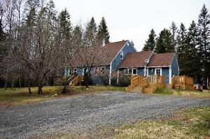 Lovely Cape Cod Styled Home sitting on over 2 acres of land!