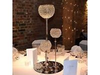 Crystal globe centrepiece £5, candelabra £9, Flower wall £100, free table runners!!! hire
