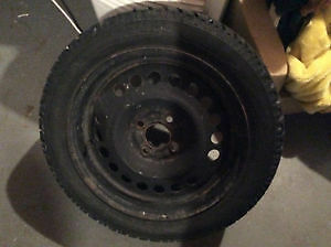 4- 185/55/R15 snow tires with rims