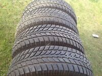 Iron man snow tires next to new shape. 215/70/16