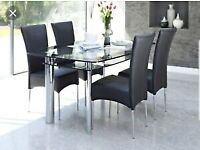 HARVEYS GLASS BOAT DINING TABLE WITH LOWER SHELF CHROME LEGS AND FREE CHAIRS