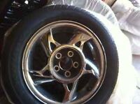 2 rims and tires off an 02 gand-am