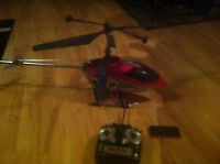 red electric helicopter needs work