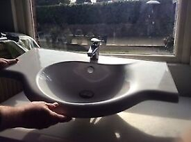 Bathroom sink. Modern wall mounted with chrome tap Porcelain White.