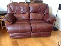 3 piece suite power recliners brown leather. 2 seater and 2 chairs