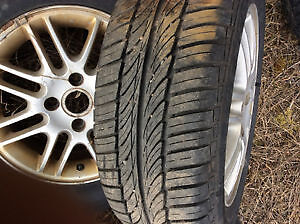 FORD FOCUS RIMS AND TIRES 2 TIRES LIKE NEW 195/65/15