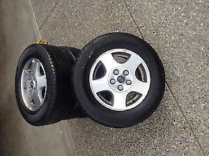 215/65/15 Goodyear all season tires on aluminum rims