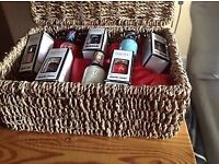 8 Nails Inc & Rimmel nail polishes, in lidded wicker hamper. Ideal gift