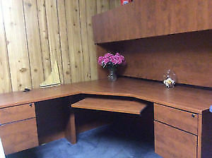 corner shaped executive desk with hutch.