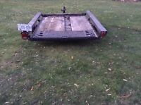 Need something moved? I have a car & utility trailer available