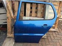 Vw polo passenger rear door in metallic blue