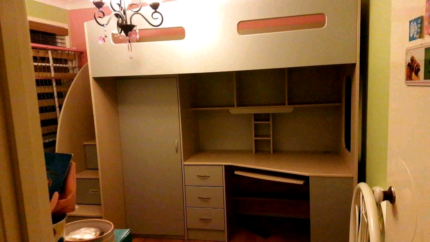 Single bunk with large desk underneath