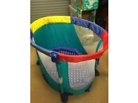 Play pen / travel cot - oval shape